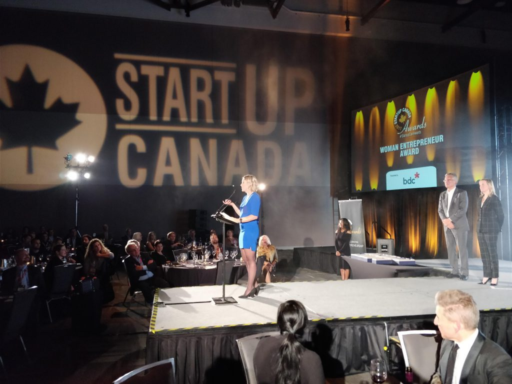 Nicole Verkindt of OMX receiving her Startup Canada award.
