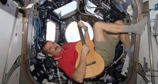 Canadian Space Agency astronaut Chris Hadfield strums his guitar in the International Space Station's Cupola on Dec. 25, 2012. Hadfield, a long-time member of an astronaut band called Max Q, later joined with the other five Expedition 34 crew members in a more spacious location to provide an assortment of Christmas carols for the public.
