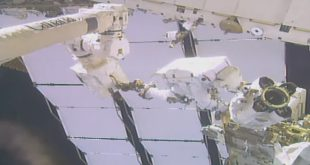 Astronauts move a Canadian built Latching End Effector