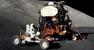 Apollo 17 mission commander Eugene Cernan drives the lunar roving vehicle during the early part of the first moonwalk at the Taurus-Littrow landing site. The Lunar Module is in the background