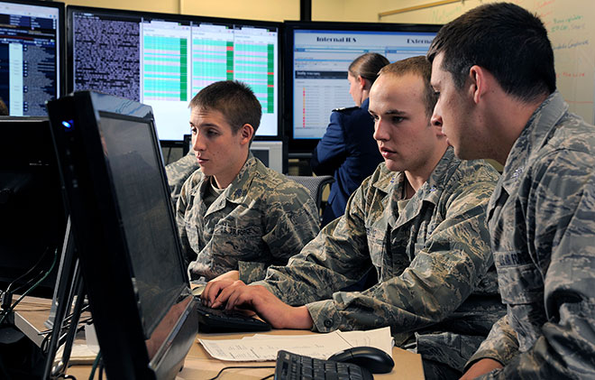 Cadet 1st Class Jordan Keefer, center, coordinates cadet efforts to defend their network during the National Security Agency's Cyber Defense Exercise April 17, 2012