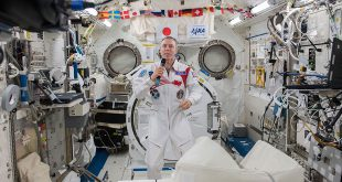 Expedition 55 Flight Engineer Drew Feustel of NASA is inside the Japanese Kibo laboratory module talking to dignitaries on Earth, including university officials, musicians and scientists, during an educational event that took place at Queen's University in Kingston, Ontario