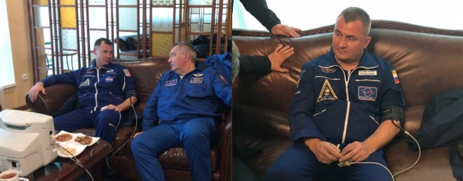 U.S. astronaut Nick Hague with ROSMOSCOS Director General Dmitry Rogozin and Russian cosmonaut Alexey Ovchinin