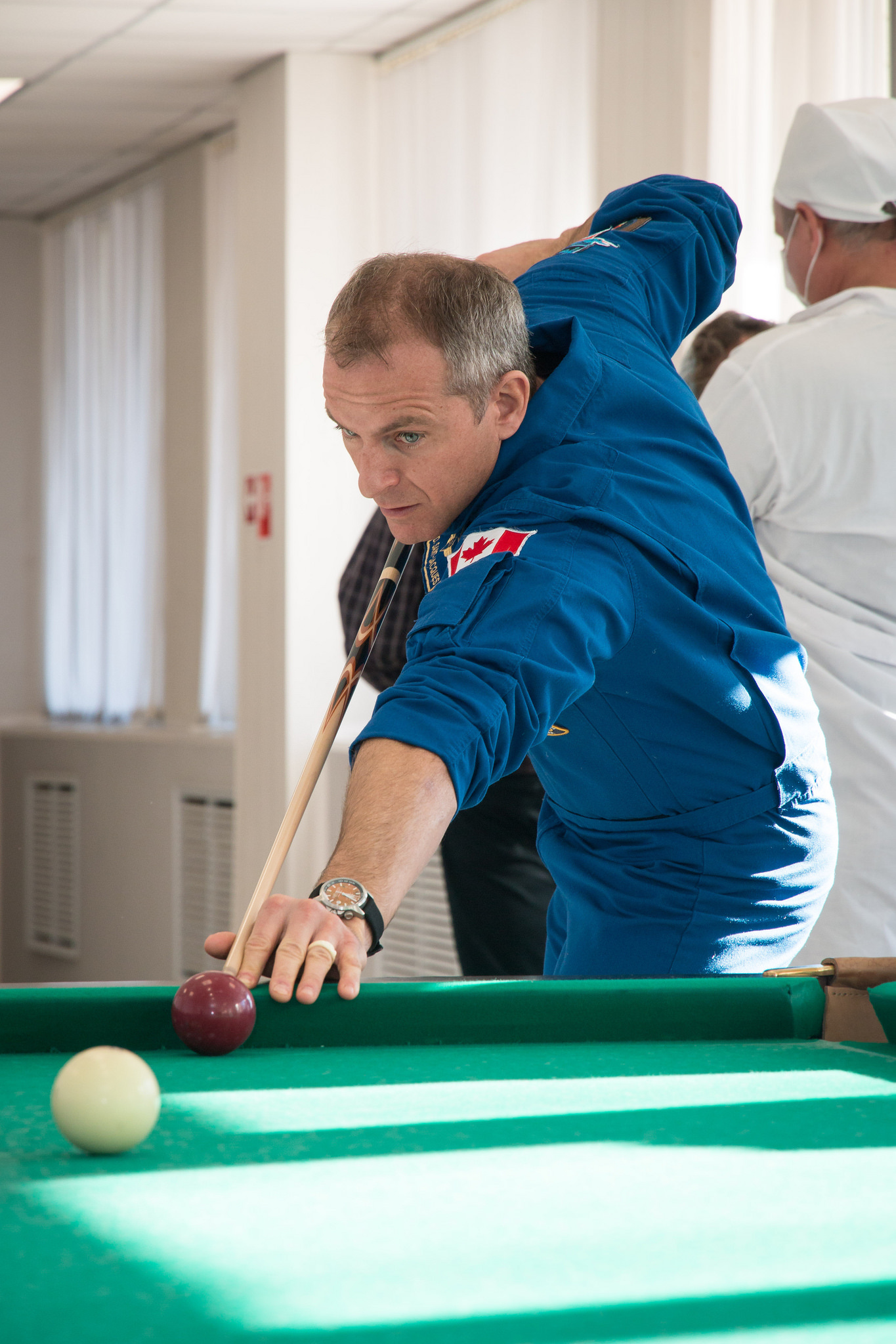 Expedition 58 crew member David Saint-Jacques plays billiards