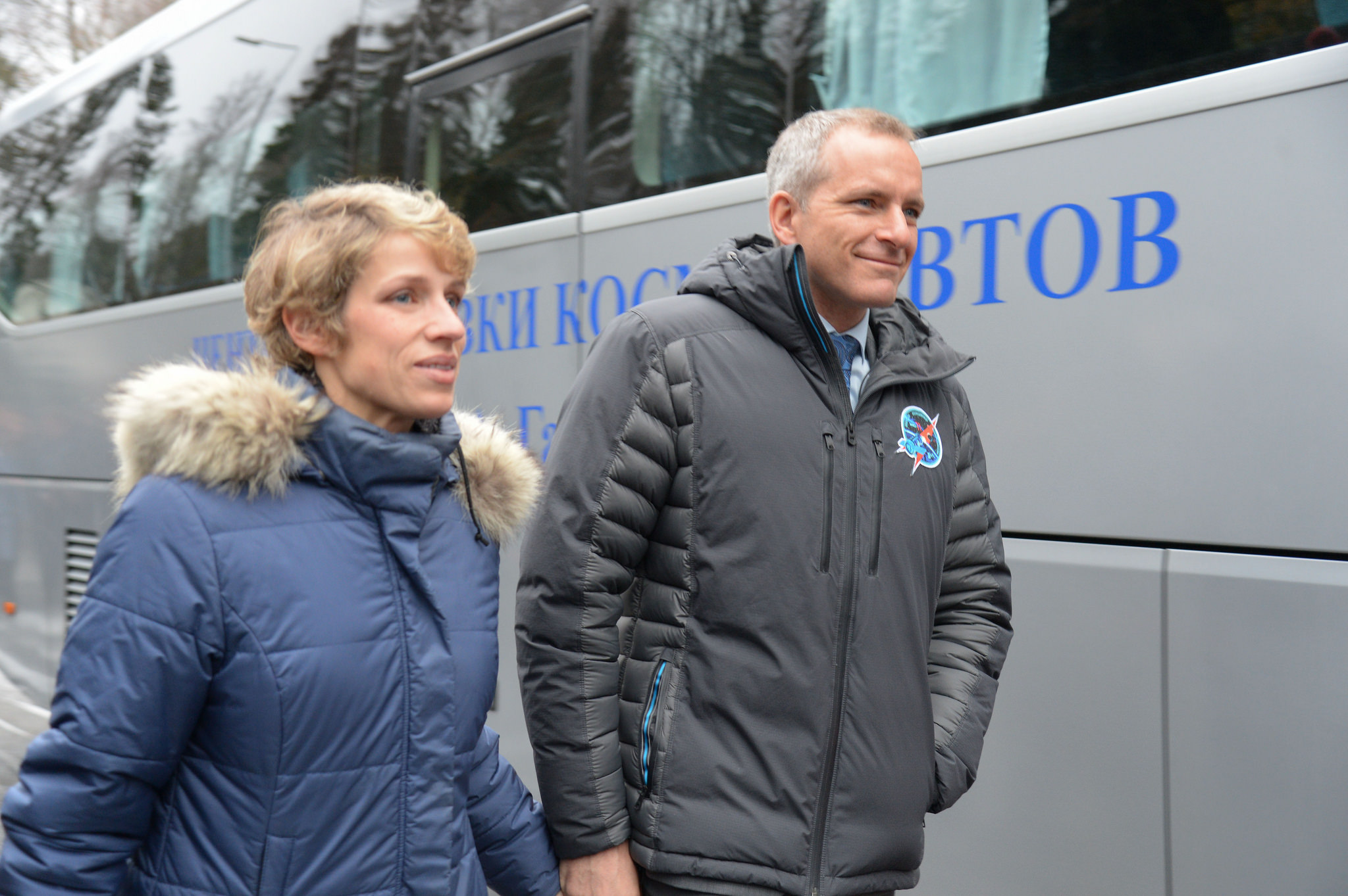 At the Gagarin Cosmonaut Training Center in Star City, Russia, Expedition 58 crew member David Saint-Jacques of the Canadian Space Agency (right) walks with his wife, Veronique, to a waiting bus Nov. 19 that will take him and his crewmates to a nearby airfield for a flight to their launch site in Baikonur, Kazakhstan. Saint-Jacques, Anne McClain of NASA and Oleg Kononenko of Roscosmos will launch Dec. 3 on the Soyuz MS-11 spacecraft from the Baikonur Cosmodrome in Kazakhstan for a six-and-a-half month mission on the International Space Station