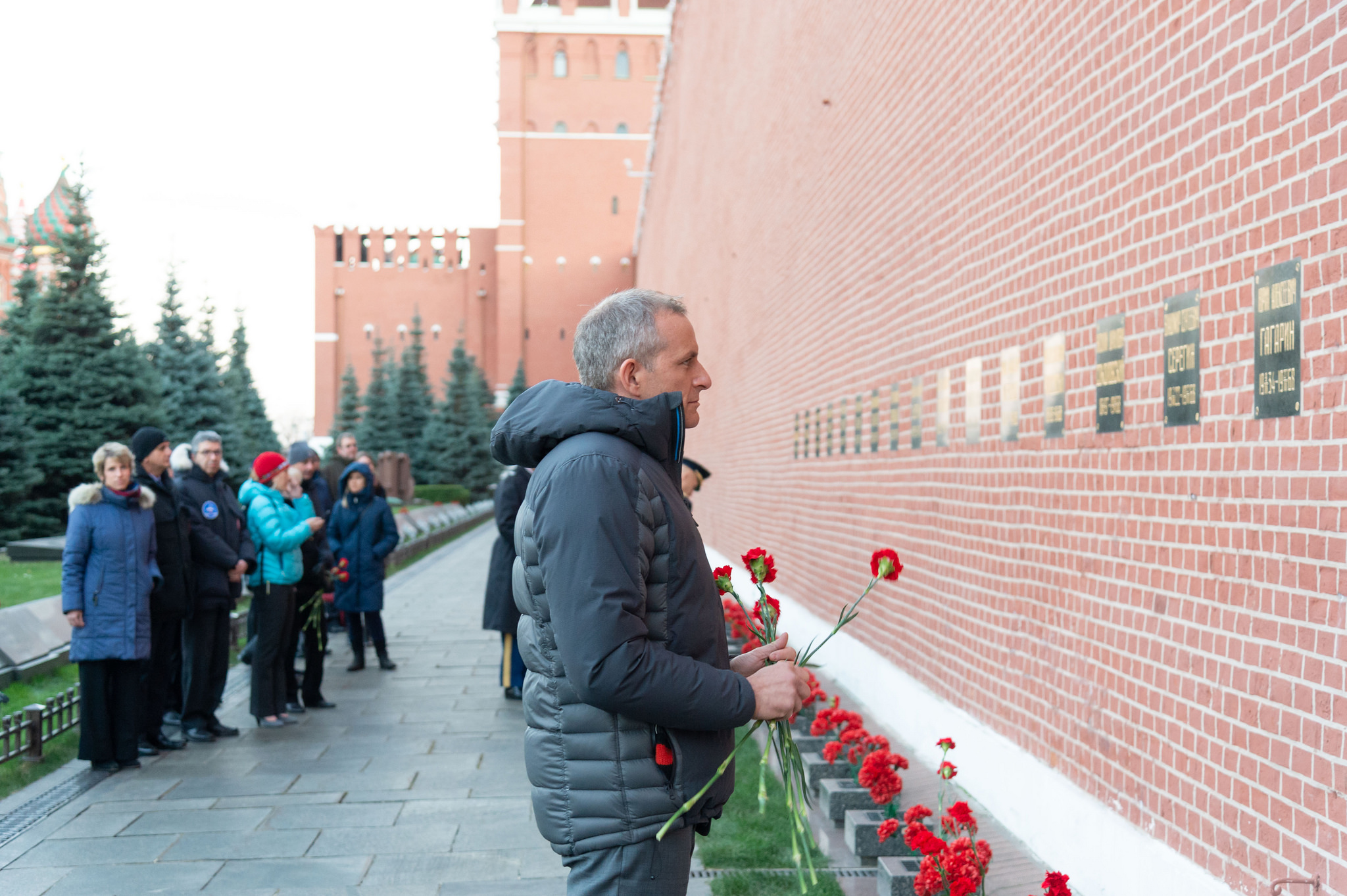 Expedition 58 crew member David Saint-Jacques of the Canadian Space Agency pays homage in traditional ceremonies Nov. 15 at the Kremlin Wall in Red Square in Moscow where Russian space icons are interred. Saint-Jacques, Anne McClain of NASA and Oleg Kononenko of Roscosmos will launch Dec. 3 on the Soyuz MS-11 spacecraft from the Baikonur Cosmodrome in Kazakhstan for a six-and-a-half month mission on the International Space Station