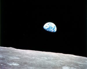 "This photo of ""Earthrise"" over the lunar horizon was taken by the Apollo 8 crew in December 1968, showing Earth for the first time as it appears from deep space"