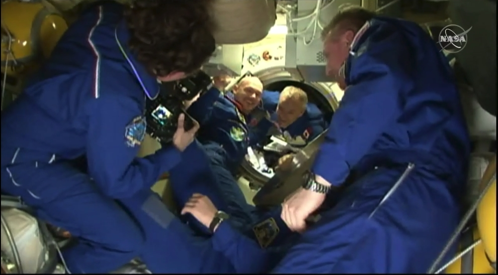 With the hatch being opened at 2:37 p.m. EST, David Saint-Jacques is seen entering the space station
