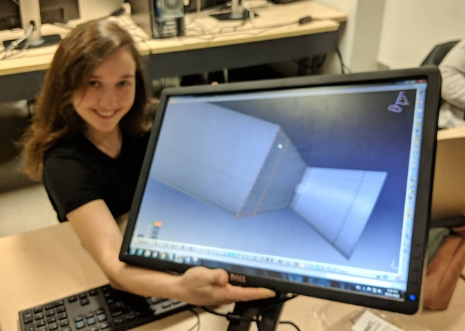 """From the RPG Facebook group: """"Our Nozzle Design Engineer Antonella showcasing our final nozzle design!!! After 4 months of design work the #ryersonpropulsiongroup is working hard this week to document our Critical Design Report! Next up? purchasing and fabrication."""" Credit: Ryerson Propulsion Group."""